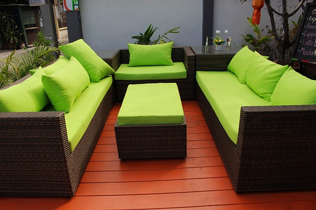 patio with green chairs and couches