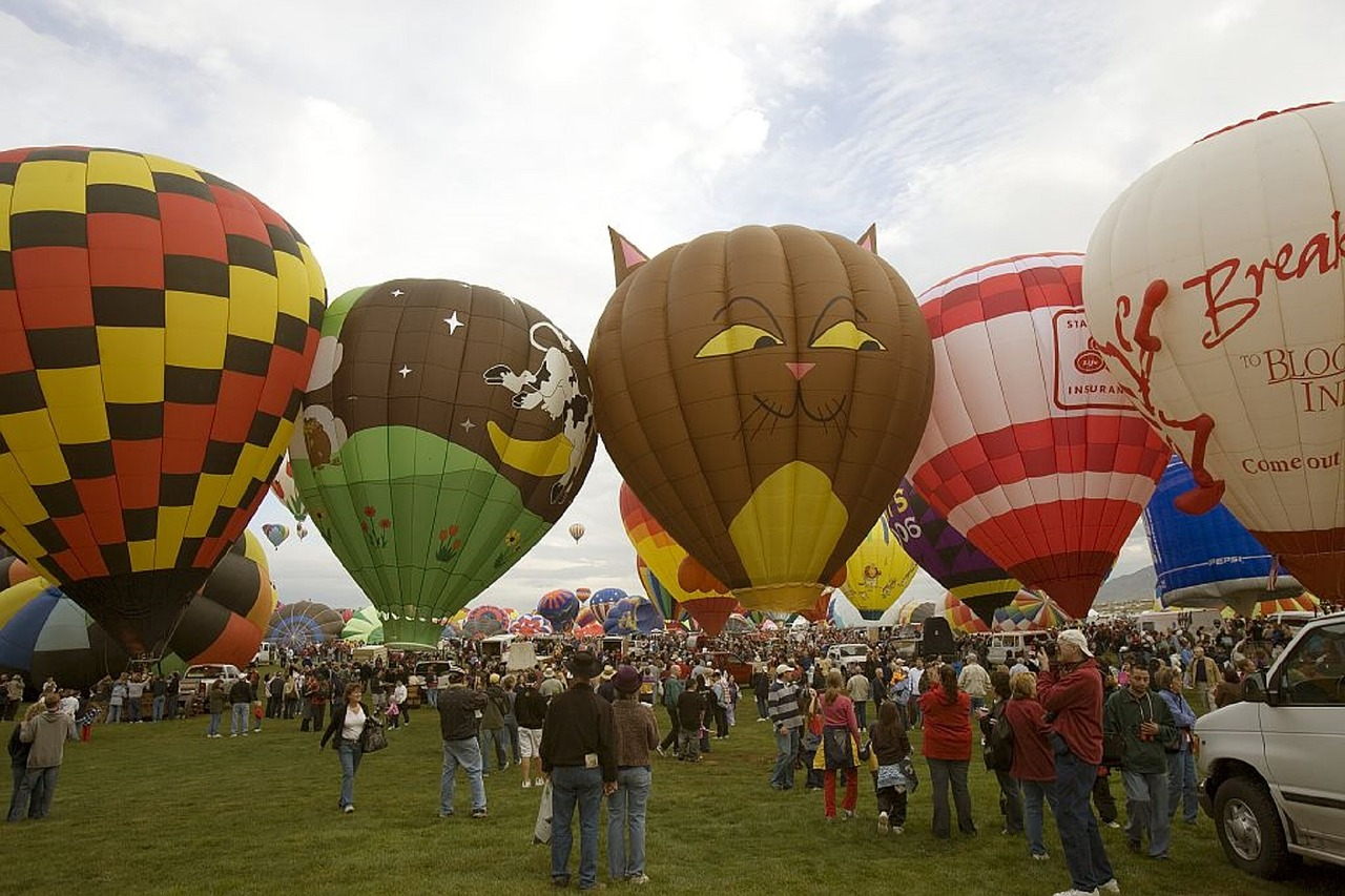 Row of hot air balloons on the ground.
