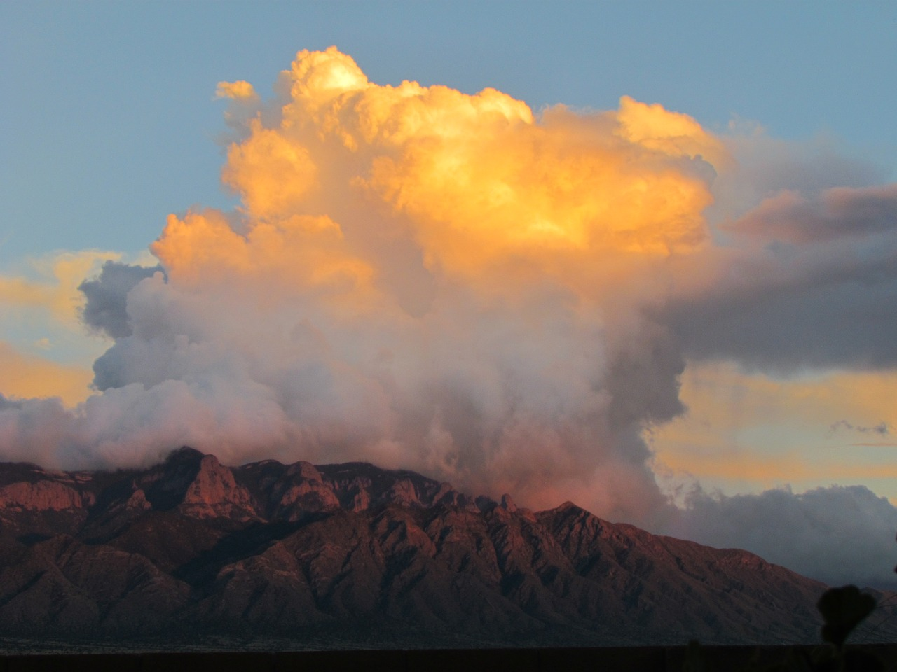 Clouds rolling over the Sandia Mountains.