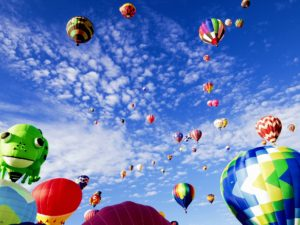 Hot air balloons drift toward the sky