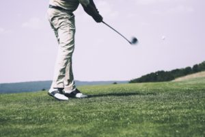 Golfer works on his causal game