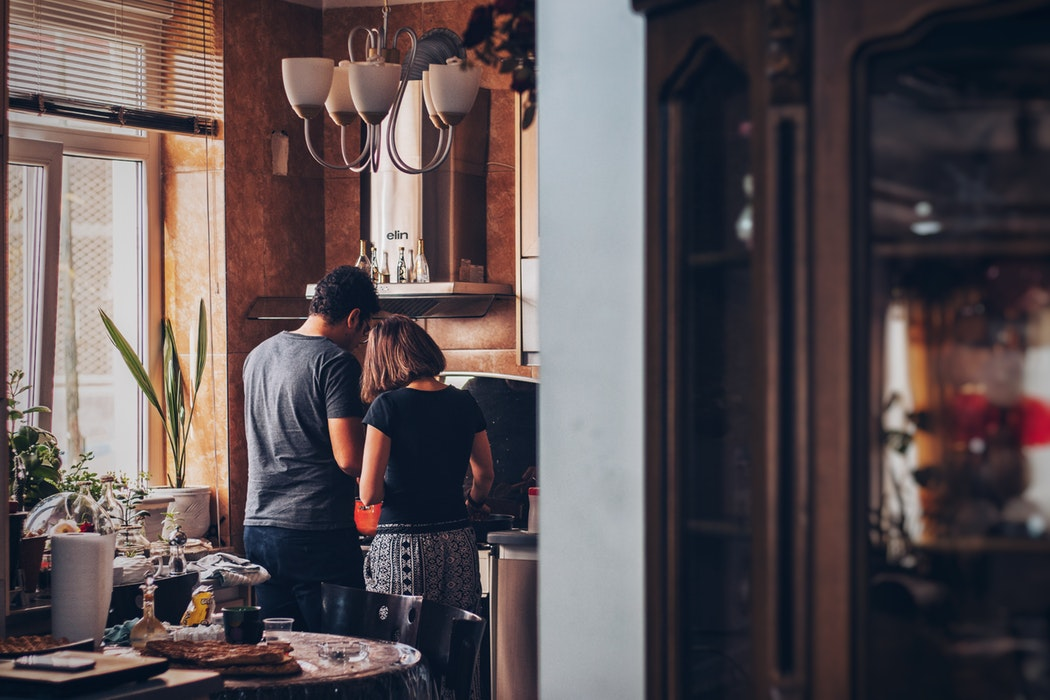 People cooking in a kitchen.