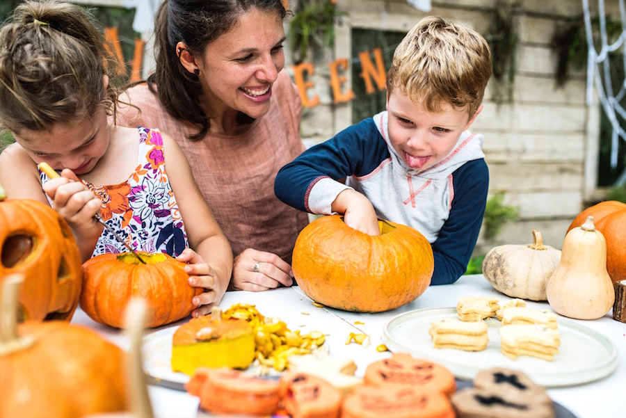 Mother and two children carving pumpkin at Santa Fe and Albuquerque Events